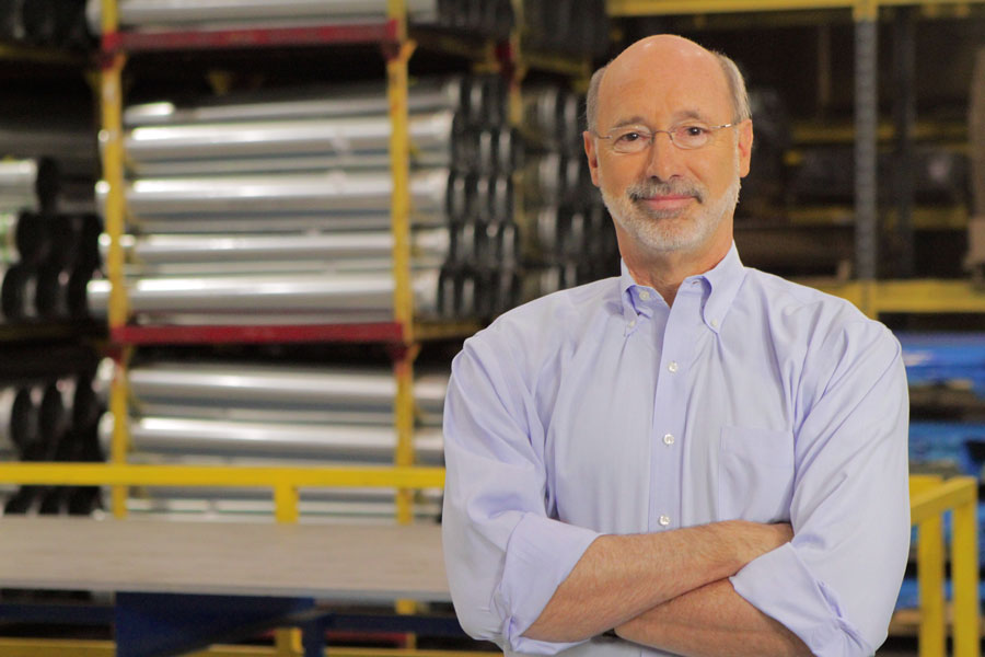 Photo of Tom Wolf at a factory